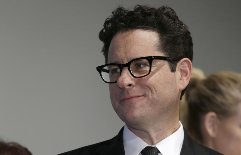 "FILE - In a Tuesday, Aug. 13, 2013 file photo, director J.J. Abrams smiles during the Japanese premiere of his film ""Star Trek Into Darkness"" in Tokyo. Abrams will accept a special honor at the 41st International Emmy Awards Gala on Monday, Nov. 25, 2013 at the Hilton New York.Zachary Quinto, who recently reprised his role of Spock in Abrams' successful reboot of the ""Star Trek"" franchise, will present the honorary International Emmy Founders Award to the director and producer. (AP Photo/Shizuo Kambayashi, File)"