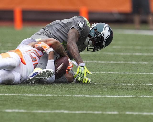Philadelphia Eagles Desean Jackson (10), of Team Sanders, has the ball stripped from him by Cleveland Browns cornerback Joe Haden (23), of Team Rice, during the second quarter at the NFL Pro Bowl football game at Aloha Stadium, Sunday. Jan. 26, 2014, in Honolulu. (AP Photo/Marco Garcia)