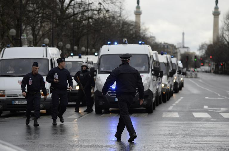 Police forces gather at Porte de Vincennes, eastern Paris, after a gunman opened fire and took hostages at a kosher grocery store