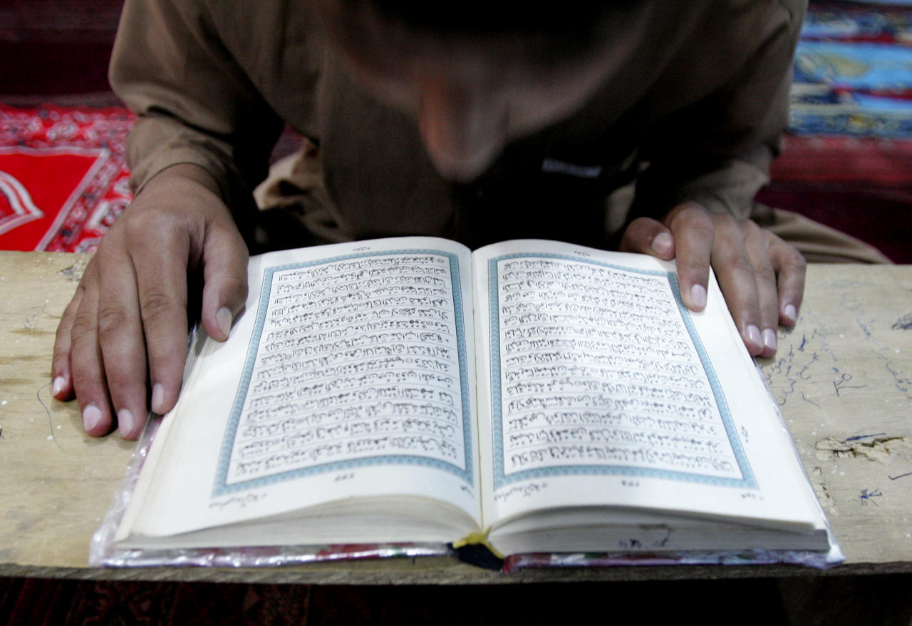 An Afghan boy reads the Quran during the Muslim holy fasting month of Ramadan at a mosque in Kabul, Afghanistan, on Thursday, Aug. 16, 2012. Ramadan is the ninth month of the Muslim year that lasts around 30 days, which strict fasting is observed from sunrise to sunset. (AP Photo/Ahmad Nazar)
