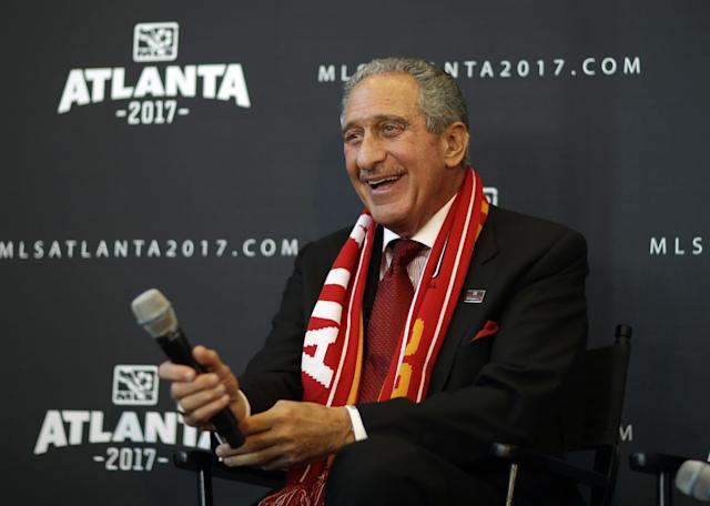 Atlanta Falcons owner Arthur Blank smiles during a news conference announcing the city is getting a Major League Soccer expansion team on Wednesday, April 16, 2014, in Atlanta. MLS announced its newest franchise, unveiling a the team for Atlanta that will begin play in 2017 at the city's new retractable roof stadium. (AP Photo/David Goldman)