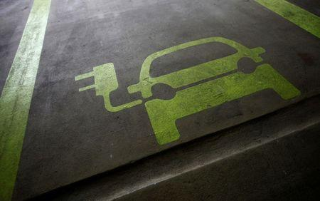 A sign is painted on a parking space for electric cars inside a car park in Hong Kong January 29, 2012. REUTERS/Tyrone Siu/Files