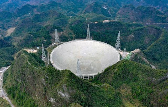 PINGTANG, Jan. 11, 2020 -- Panoramic photo taken on Jan. 11, 2020 shows China's Five-hundred-meter Aperture Spherical radio Telescope, FAST, under maintenance in southwest China's Guizhou Province. China completed commissioning of the world's largest and most sensitive radio telescope on Saturday, putting it into formal operation after a productive three-year trial. The telescope will gradually open to astronomers around the globe, providing them with a powerful tool to uncover the mysteries surrounding the genesis and evolutions of the universe. (Photo by Liu Xu/Xinhua via Getty) (Xinhua/Liu Xu via Getty Images)