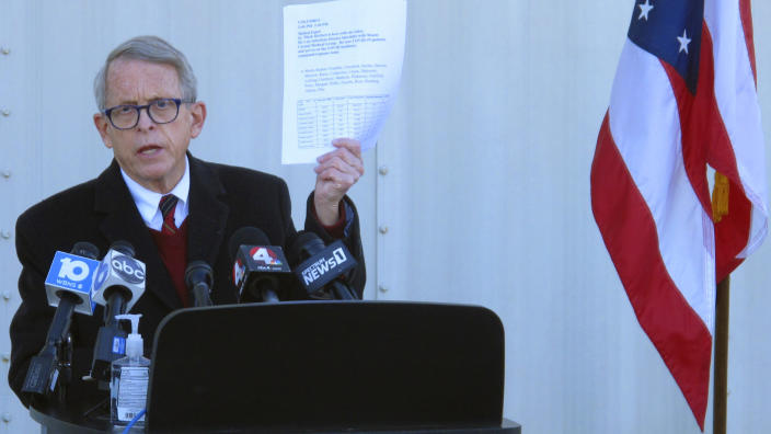 FILE - In this Nov. 18, 2020 file photo, Republican Ohio Gov. Mike DeWine discusses the most recent data on Ohio's soaring coronavirus cases during a news briefing at John Glenn International Airport on in Columbus, Ohio. State lawmakers across the country will be convening in 2021 with the continuing COVID-19 pandemic rippling through much of their work — and even affecting the way they work. After 10 months of emergency orders and restrictions from governors and local executive officials, some state lawmakers are eager to reassert their power over statewide decisions shaping the way people shop, work, worship and attend school. (AP Photo/Andrew Welsh-Huggins, File)