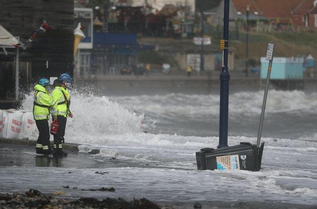 Members of the Coastguard monitor the conditions at Swanage