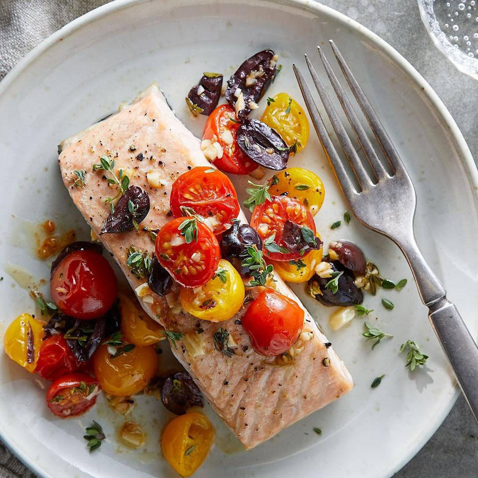 <p>Keep the mess to minimum with this easy sheet-pan dinner. Cherry tomato halves roast alongside salmon fillets and make a delicious topping combined with olives, garlic and thyme in this easy fuss-free dinner.</p>