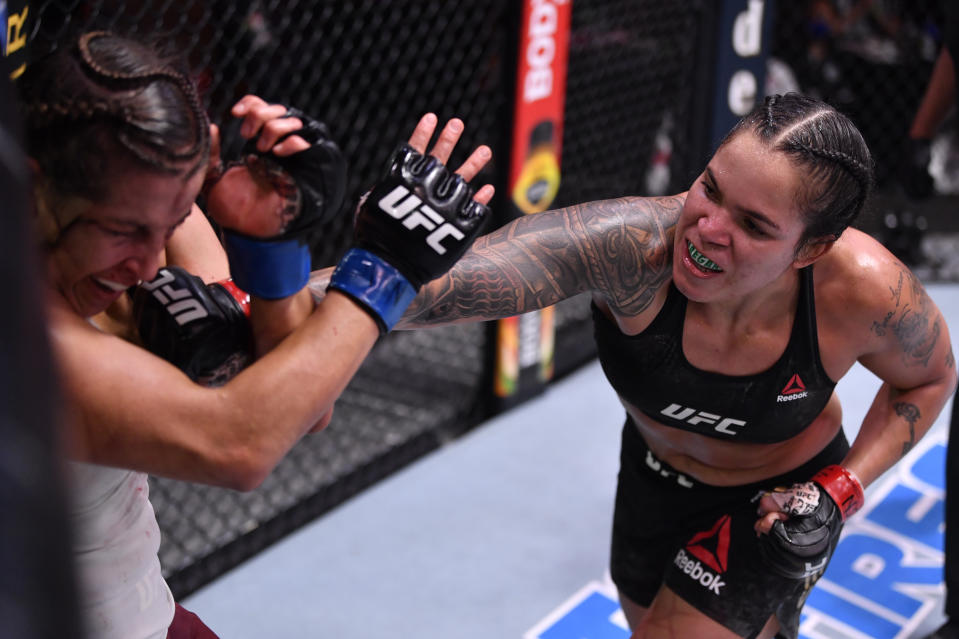 LAS VEGAS, NEVADA - JUNE 06: (R-L) Amanda Nunes of Brazil punches Felicia Spencer of Canada in their UFC featherweight championship bout during the UFC 250 event at UFC APEX on June 06, 2020 in Las Vegas, Nevada. (Photo by Jeff Bottari/Zuffa LLC)