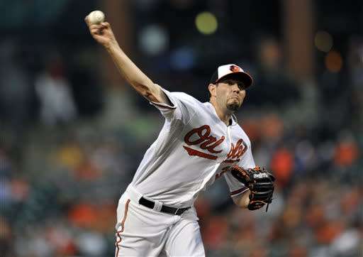 Baltimore Orioles pitcher Jason Hammel delivers against the Cleveland Indians in the first inning of a baseball game Wednesday, June 26, 2013 in Baltimore. (AP Photo/Gail Burton)