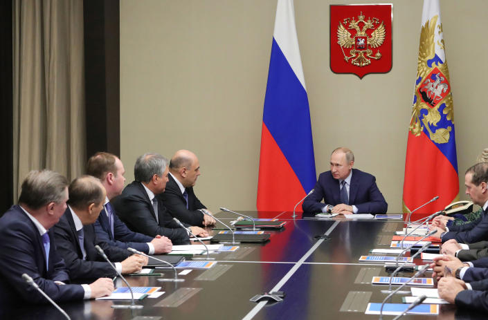 Russian President Vladimir Putin, center, chairs a Security Council meeting at the Novo-Ogaryovo residence outside Moscow in Moscow, Russia, Monday, Jan. 20, 2020. (Mikhail Klimentyev, Sputnik, Kremlin Pool Photo via AP)