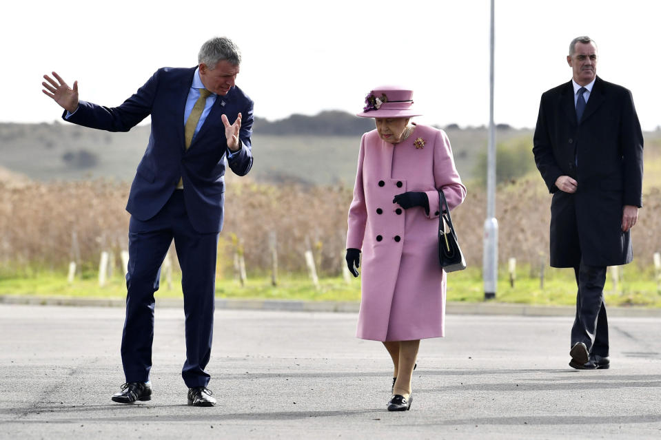 Britain's Queen Elizabeth II is greeted by Chief Executive Gary Aitkenhead prior to a visit to the Defence Science and Technology Laboratory (DSTL) at Porton Down, England, Thursday Oct. 15, 2020, to view the Energetics Enclosure and display of weaponry and tactics used in counter intelligence. (Ben Stansall/Pool via AP)