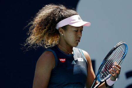 Mar 22, 2019; Miami Gardens, FL, USA; Naomi Osaka of Japan adjusts her strings between points against Yanina Wickmayer of Belgium (not pictured) in the second round of the Miami Open at Miami Open Tennis Complex. Mandatory Credit: Geoff Burke-USA TODAY Sports
