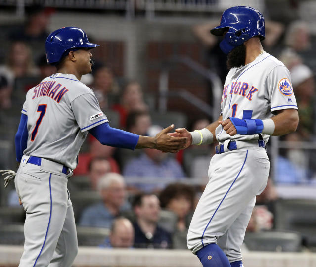 New York Mets Marcus Stroman, left, and Amed Rosario celebrate after scoring against the Atlanta Braves during the fifth inning of a baseball game Thursday, Aug. 15, 2019, in Atlanta. (AP Photo/Tami Chappell)
