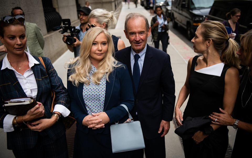 David Boies, representing several of Jeffrey Epstein's alleged victims, center, arrives with Annie Farmer, second right, and Virginia Giuffre, alleged victims of Jeffrey Epstein, second left, at federal court in New York in 2019 - Mark Kauzlarich/Bloomberg