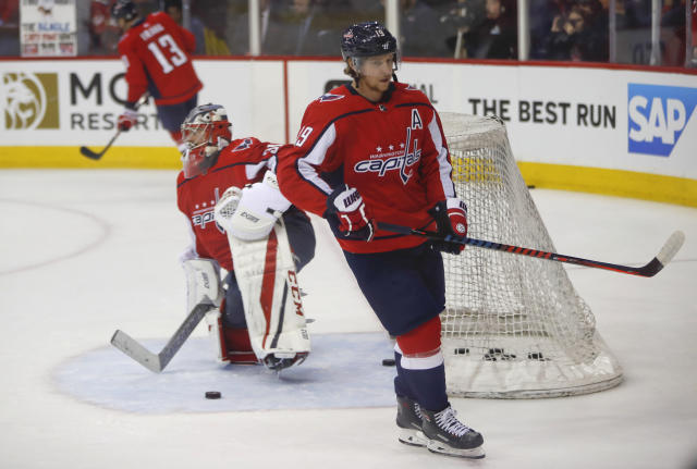 Washington Capitals center Nicklas Backstrom (19), from Sweden, skates past Capitals goaltender Philipp Grubauer (31) before Game 4 of the NHL Eastern Conference finals hockey playoff series against the Tampa Bay Lightning, Thursday, May 17, 2018, in Washington. (AP Photo/Pablo Martinez Monsivais)