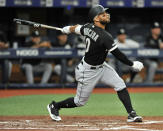 Chicago White Sox's Yoan Moncada hits a RBI-double off Tampa Bay Rays starter Brendan McKay during the second inning of a baseball game Friday, July 19, 2019, in St. Petersburg, Fla. (AP Photo/Steve Nesius)