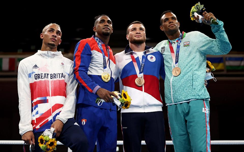 Ben Whittaker, Arlen Lopez, Imam Khataev and Loren Alfonso pose with their light-heavyweight medals - GETTY IMAGES