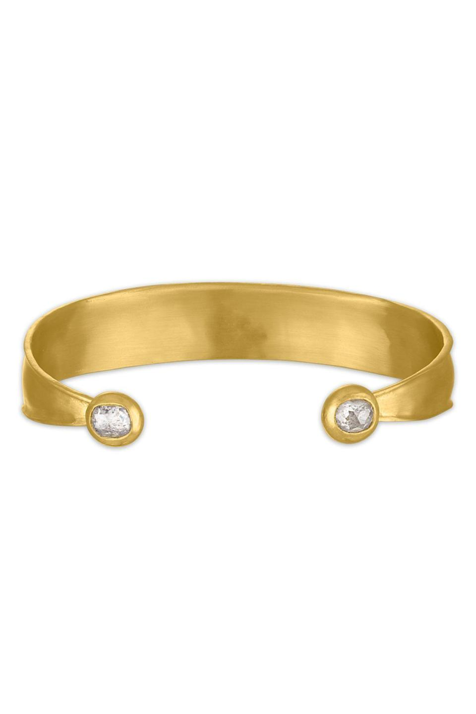 """<p><strong>Prounis</strong></p><p>prounisjewelry.com</p><p><a href=""""https://www.prounisjewelry.com/collections/bracelets/products/laurel-cuff-with-diamonds"""" rel=""""nofollow noopener"""" target=""""_blank"""" data-ylk=""""slk:Shop Now"""" class=""""link rapid-noclick-resp"""">Shop Now</a></p><p>This commanding gold cuff by Prounis will make any outfit chic. </p>"""