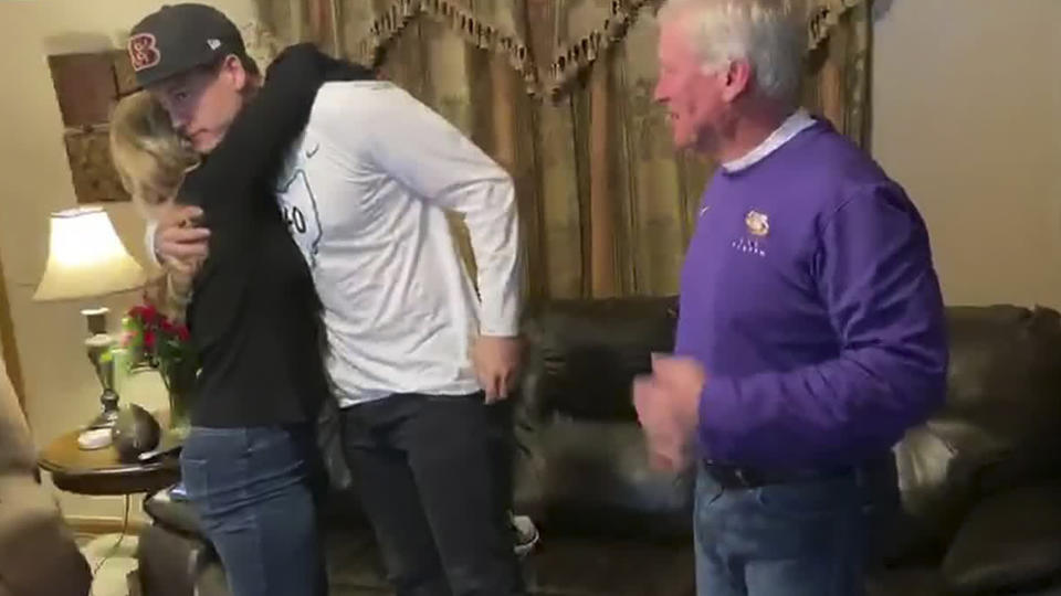 In this still image from video provided by the NFL, LSU quarterback Joe Burrow celebrates in The Plains, Ohio, after being chosen first by the Cincinnati Bengals in Thursday's draft. (NFL via AP)