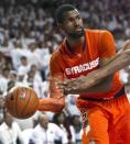 Syracuse's James Southerland looks to pass during the second half of an NCAA college basketball game against Arkansas in Fayetteville, Ark., Friday, Nov. 30, 2012. Southerland scored a team-high 35 point as Syracuse defeated Arkansas 91-82. (AP Photo/Gareth Patterson)