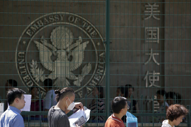<p>Visa applicants wait to enter the U.S. Embassy near the site of an explosion in Beijing, Thursday, July 26, 2018. A man exploded a small homemade bomb outside the U.S. Embassy, injuring only himself, according to police and an embassy spokesperson. (Photo: Ng Han Guan/AP) </p>