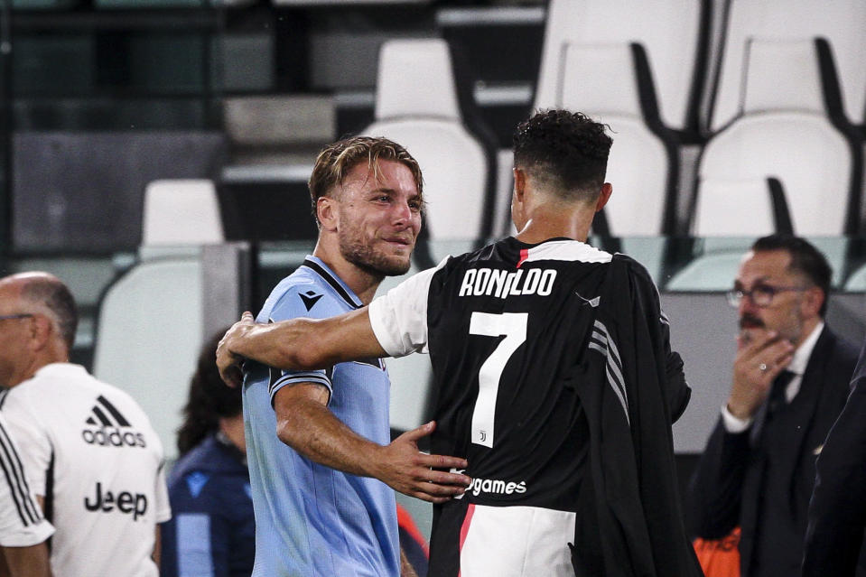 Juventus forward Cristiano Ronaldo (7) talks with Lazio forward Ciro Immobile (17) during the Serie A football match n.34 JUVENTUS - LAZIO on July 20, 2020 at the Allianz Stadium in Turin, Piedmont, Italy. (Photo by Matteo Bottanelli/NurPhoto via Getty Images)