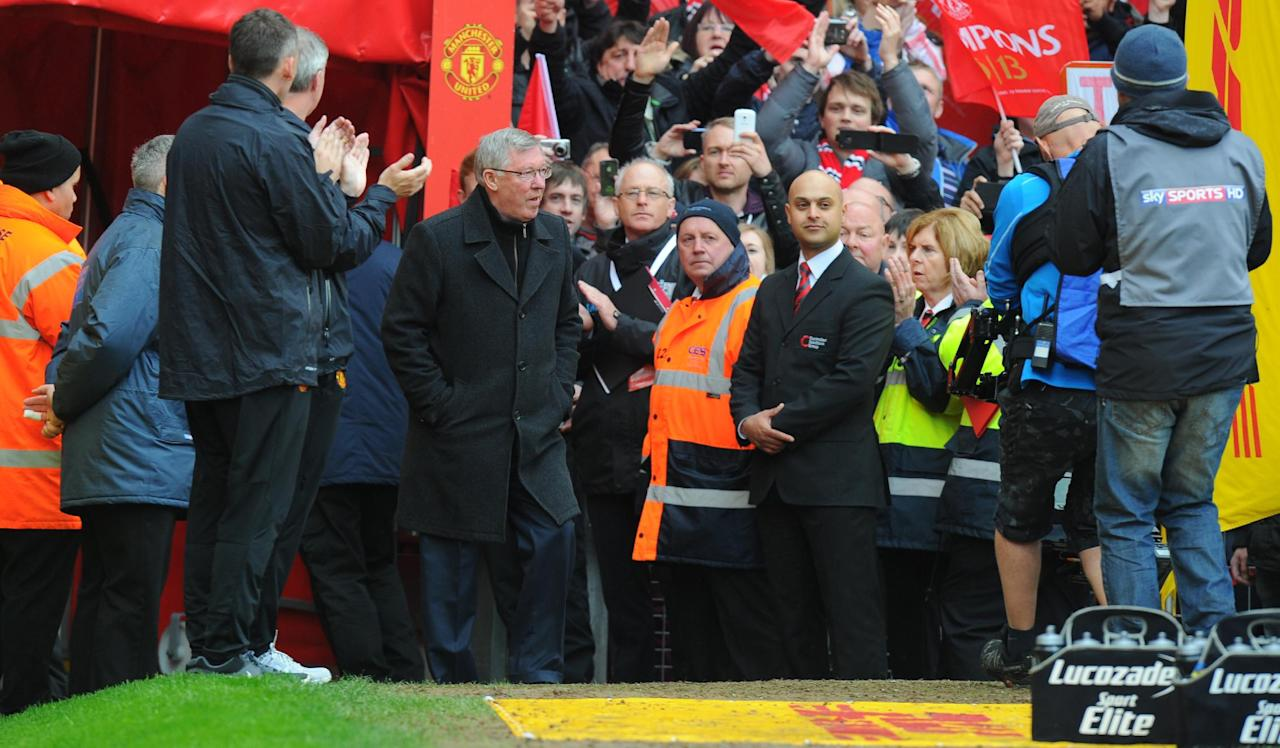 Manchester United manager Sir Alex ferguson walks on to the pitch before taking his seat for his last Barclays Premier League match at Old Trafford, Manchester.