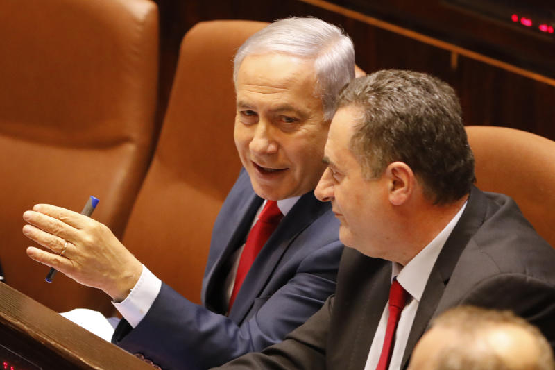 Israeli Prime Minister Benjamin Netanyahu before voting in the Knesset, Israel's parliament in Jerusalem, Wednesday, May 29, 2019. Israel's parliament has voted to dissolve itself, sending the country to an unprecedented second snap election this year as Prime Minister Benjamin Netanyahu failed to form a governing coalition before a midnight deadline. (AP Photo/Sebastian Scheiner)