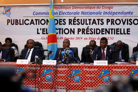 Members of Congo's Independent National Electoral Commission (CENI) attend a press conference announcing the results of the presidential election in Kinshasa, Democratic Republic of Congo, January 10, 2019. REUTERS/Jackson Njehia