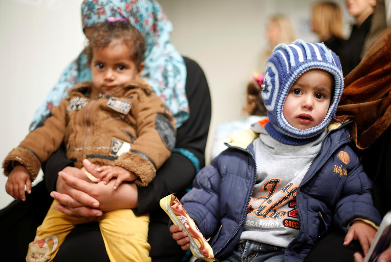 Syrian refugees children wait with their mothers to receive treatment at a health center, during the visit of President of Slovenia Borut Pahor to the refugee camp Al Zaatari in Jordan, near the border with Syria, December 3, 2016. REUTERS/Muhammad Hamed
