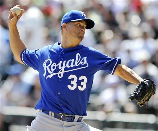 Kansas City Royals starter Jeremy Guthrie delivers a pitch in the first inning during a baseball game against the Chicago White Sox in Chicago, Sunday, Sept. 9, 2012. (AP Photo/Paul Beaty)