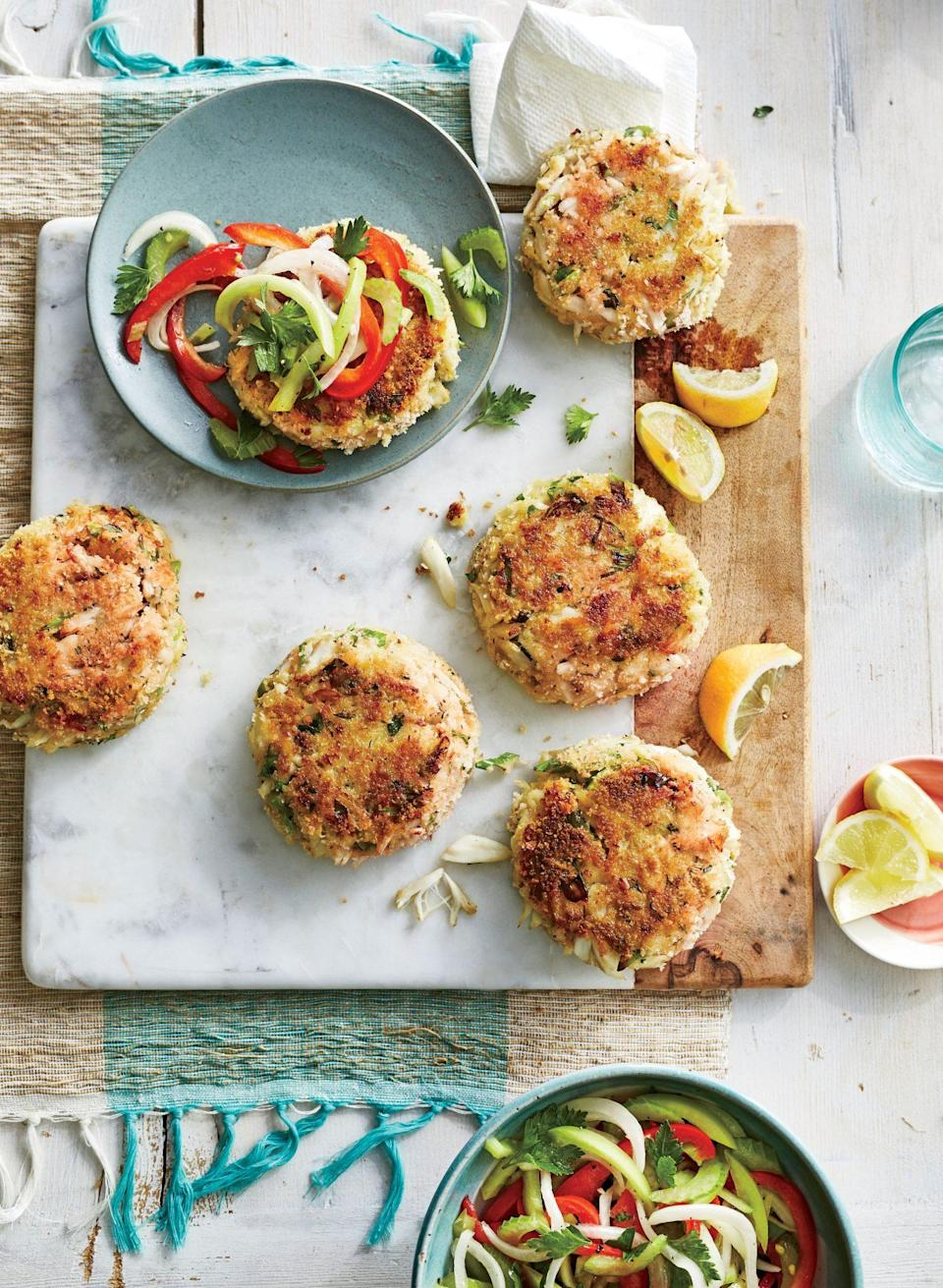 """<p><strong>Recipe:</strong> <a href=""""https://www.southernliving.com/recipes/best-ever-crab-cakes-recipe"""" rel=""""nofollow noopener"""" target=""""_blank"""" data-ylk=""""slk:Best-Ever Crab Cakes with Green Tomato Slaw"""" class=""""link rapid-noclick-resp"""">Best-Ever Crab Cakes with Green Tomato Slaw</a></p> <p>These really are the Best-Ever Crab Cakes. Crispy and topped with a tangy slaw, they're a great dish to have on hand for your next gathering. Top them with a sunny-side-up egg for a breakfast that's over the top. </p>"""