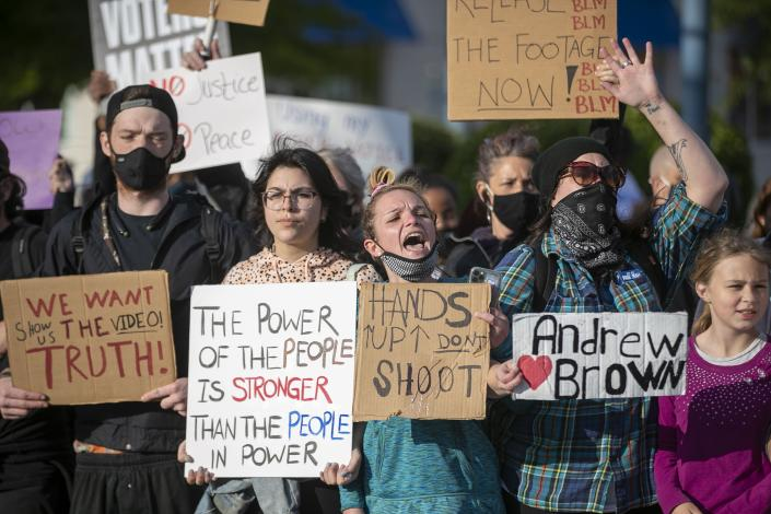 Demonstrators organize on Colonial Ave. to march, Thursday, April 22, 2021, Elizabeth City, N.C., in reaction to the death of Andrew Brown Jr., who was shot and killed by a Pasquotank County Deputy Sheriff earlier in the week. (Robert Willett/The News & Observer via AP)