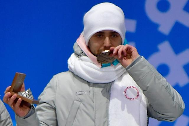 Russia's bronze medallist Alexander Krushelnitsky is banned from the Olympics and must return his medal in the mixed curling event, the Court of Arbitration for Sport announced Thursday. (AFP Photo/Martin BUREAU)