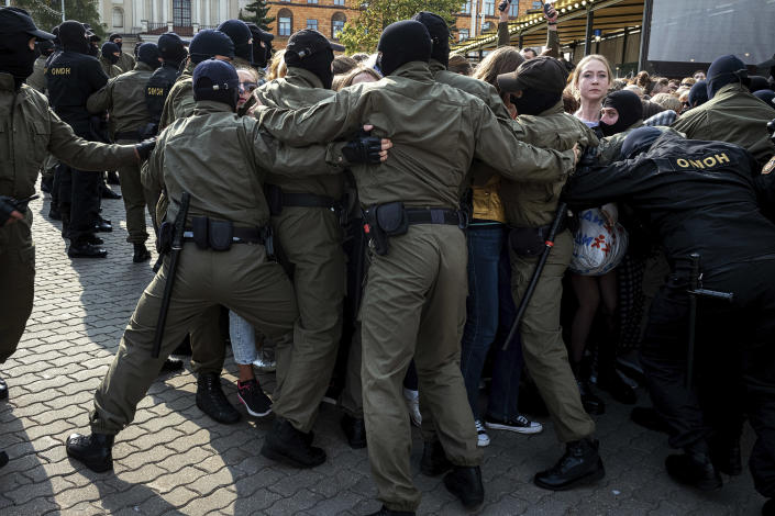 Police officers block and detain protesters during an opposition rally to protest the official presidential election results in Minsk, Belarus, Saturday, Sept. 12, 2020. Daily protests calling for the authoritarian president's resignation are now in their second month and opposition determination appears strong despite the detention of protest leaders. (AP Photo/Misha Friedman)