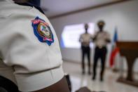 A Haitian National Police officer attends Haitian's Police Director General Leon Charles press conference