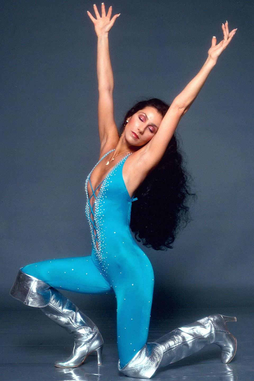 <p>All hail Cher in this electric blue jumpsuit circa 1978. </p>