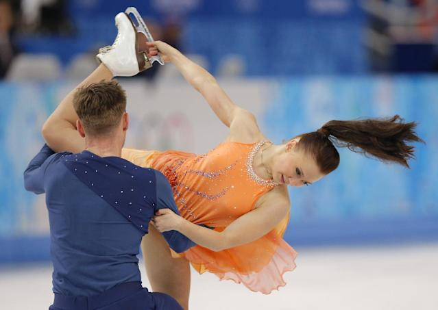 Julia Zlobina and Alexei Sitnikov of Azerbaijan compete in the ice dance free dance figure skating finals at the Iceberg Skating Palace during the 2014 Winter Olympics, Monday, Feb. 17, 2014, in Sochi, Russia. (AP Photo/Vadim Ghirda)