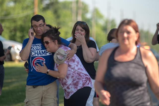 <p>Parents comfort each other as they wait outside Noblesville West Middle School after a shooting at the school on May 25, 2018 in Noblesville, Ind. (Photo: Kevin Moloney/Getty Images) </p>