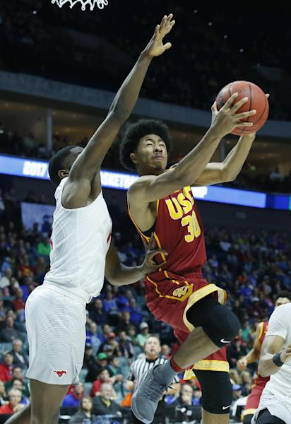 Southern California guard Elijah Stewart (30) shoots in front of Southern Methodist guard Shake Milton, left, in the first half of a first-round game in the men's NCAA college basketball tournament in Tulsa, Okla., Friday, March 17, 2017. (AP Photo/Sue Ogrocki)