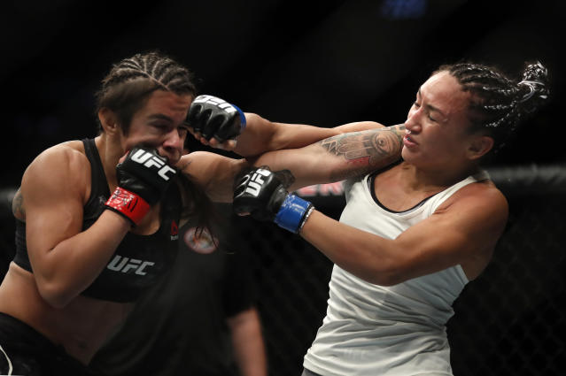 Claudia Gadelha,left, and Carla Esparza fight during their women's strawweight UFC 225 Mixed Martial Arts bout Saturday, June 9, 2018, in Chicago. (AP Photo/Jim Young)