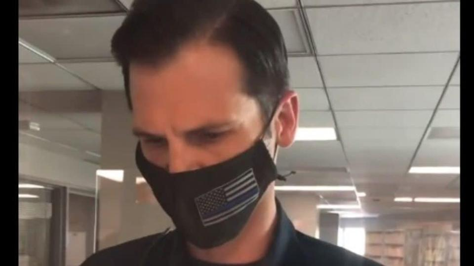Beverly Hills police Sgt. Billy Fair is shown in the Instagram Live video shot by activist Sennett Devermont capturing the officer turning on music on his cell phone to avoid the recording's posting on social media. (Instagram)