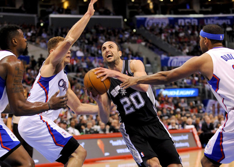 San Antonio Spurs guard Manu Ginobili (20), of Argentina, drives on Los Angeles Clippers forward Blake Griffin. left center, center DeAndre Jordan, left, and forward Jared Dudle, right, as he goes to the basket in the first half of a NBA basketball game, Tuesday, Feb. 18, 2014, in Los Angeles.(AP Photo/Gus Ruelas)