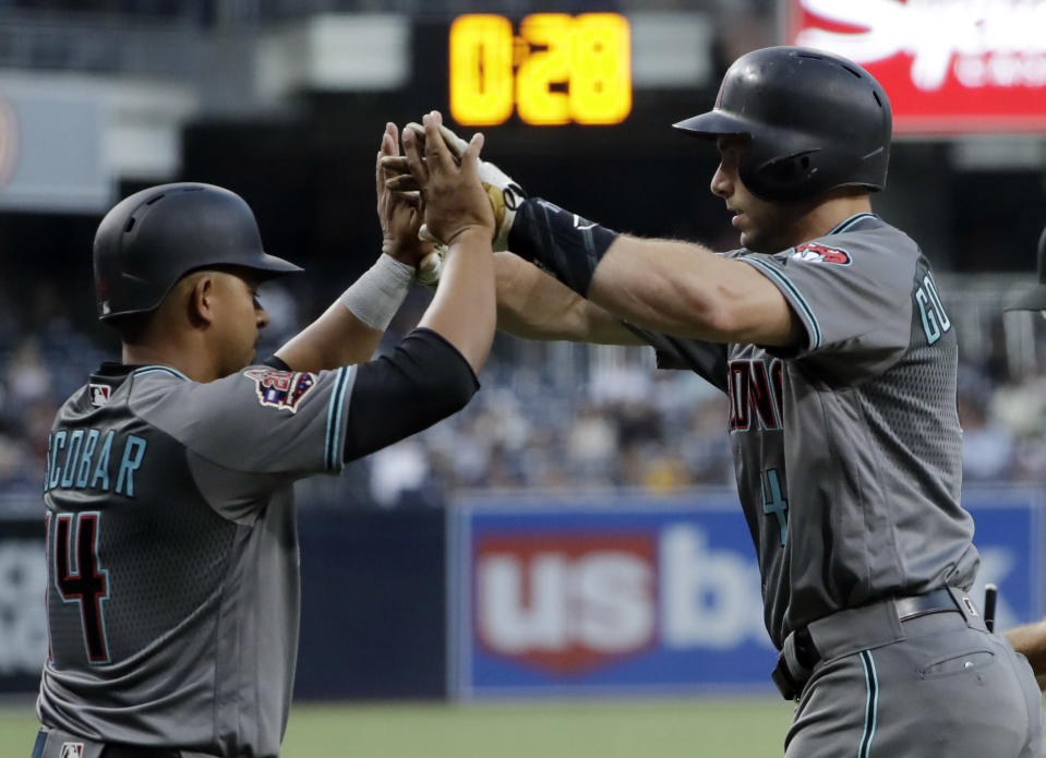 Arizona Diamondbacks' Paul Goldschmidt, right, is greeted by Eduardo Escobar after hitting a two-run home run during the first inning of a baseball game against the San Diego Padres on Friday, Aug. 17, 2018, in San Diego. (AP Photo/Gregory Bull)