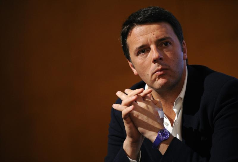 File photo of centre-left leader Renzi attending a political meeting in Turin