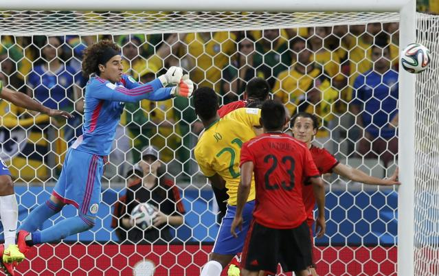 Mexico's goalkeeper Guillermo Ochoa makes a save during the 2014 World Cup Group A soccer match between Brazil and Mexico at the Castelao arena