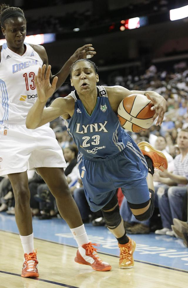 Minnesota Lynx' Maya Moore (23) is fouled by Atlanta Dream's Aneika Henry (13) during the second half of Game 3 of the WNBA Finals basketball series, in Duluth, Ga., Thursday, Oct. 10, 2013. (AP Photo/John Bazemore)