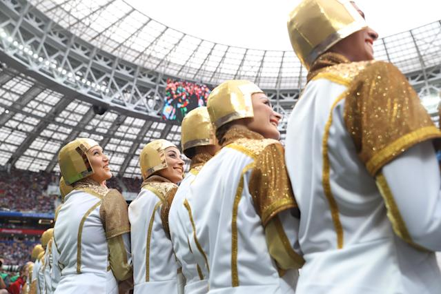 <p>Performers look on during the opening ceremony prior to the 2018 FIFA World Cup Russia Group A match between Russia and Saudi Arabia at Luzhniki Stadium on June 14, 2018 in Moscow, Russia. (Photo by Lars Baron – FIFA/FIFA via Getty Images) </p>