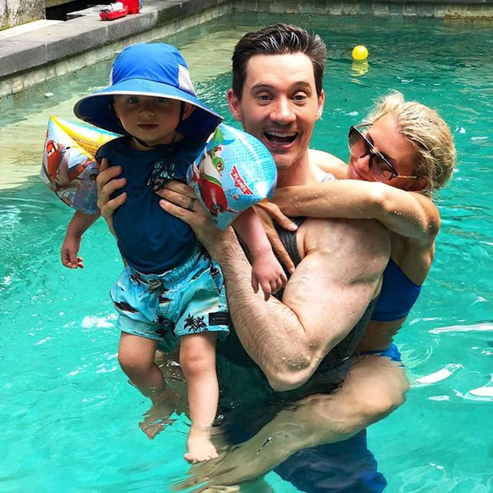 Tiffiny Hall in a swimming pool with her husband, Ed Kavalee, and their son, Arnold. Photo: Instagram/tiffhall_xo.