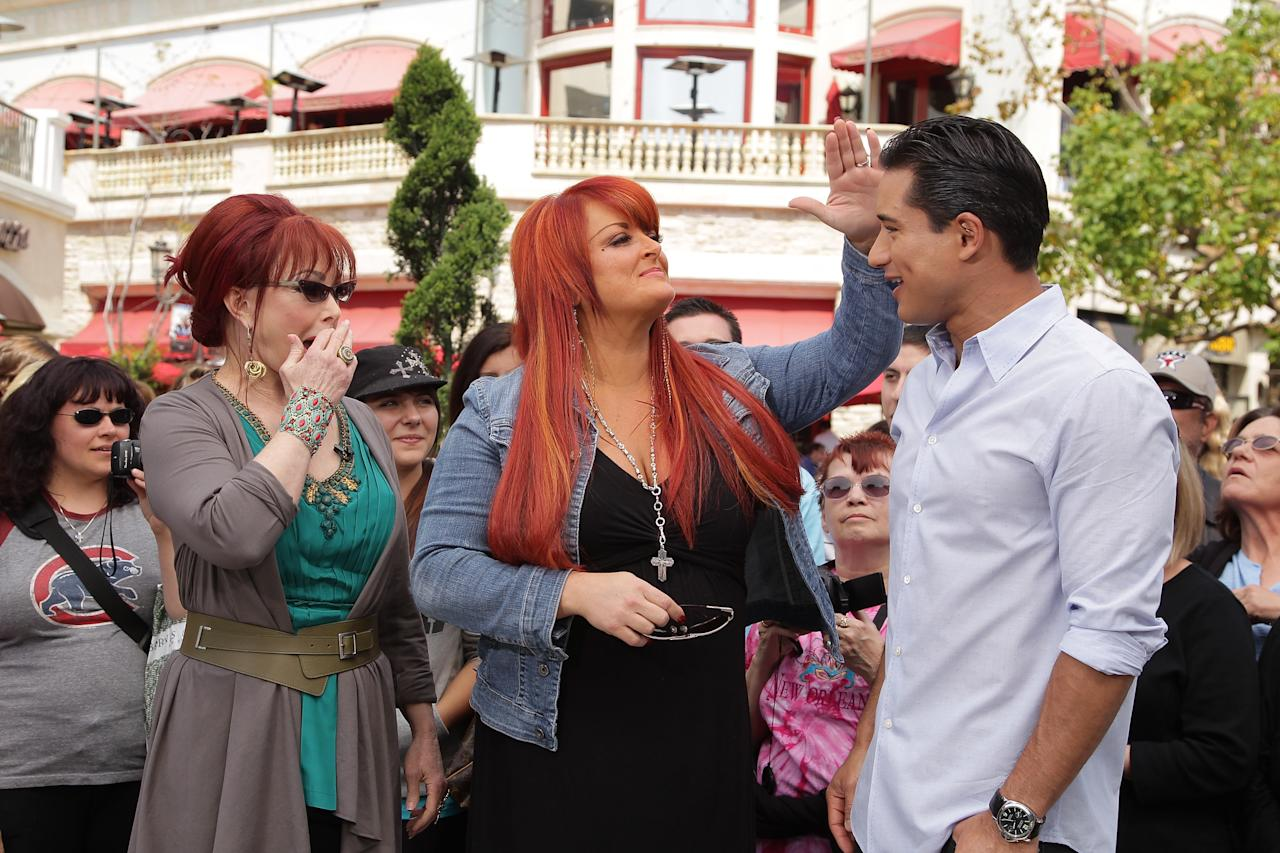 "Naomi and Wynonna Judd chatted up and kidded around with Mario Lopez on Wednesday at The Grove in Los Angeles. The three filmed a segment for Mario's show, ""Extra,"" to promote the mother-daughter duo's new ""The Last Encore"" tour. Noel Vasquez/<a href=""http://www.gettyimages.com/"" target=""new"">GettyImages.com</a> - April 13, 2011"