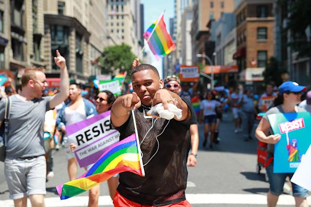 <p>A young man shows love for the camera as he marches down Fifth Avenue in N.Y.C. Pride Parade in New York on June 25, 2017. (Photo: Gordon Donovan/Yahoo News) </p>